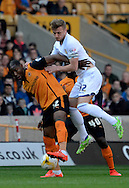 Liam Cooper challenges Benik Afobe during the Sky Bet Championship match between Wolverhampton Wanderers and Leeds United at Molineux, Wolverhampton, England on 6 April 2015. Photo by Alan Franklin.