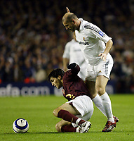 Photo: Chris Ratcliffe.<br /> Arsenal v Real Madrid. UEFA Champions League. 08/03/2006.<br /> Cesc Fabregas is tackled by Zinedine Zidane