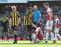 FOOTBALL - 2018 / 2019 Premier League - Arsenal vs. Watford<br /> <br /> Nacho Monreal of Arsenal is helped to his feet after being fouled by Troy Deeney of Watford,who was booked by Referee, Anthony Taylor, at the Emirates<br /> <br /> COLORSPORT/ANDREW COWIE