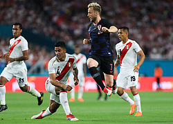 March 23, 2018 - Miami Gardens, Florida, USA - Croatia midfielder Ivan Rakitic (7) jumps between Peru midfielder Anderson Santamaria (4) and Peru defender Yoshimar Yotun (19) during a FIFA World Cup 2018 preparation match between the Peru National Soccer Team and the Croatia National Soccer Team at the Hard Rock Stadium in Miami Gardens, Florida. (Credit Image: © Mario Houben via ZUMA Wire)