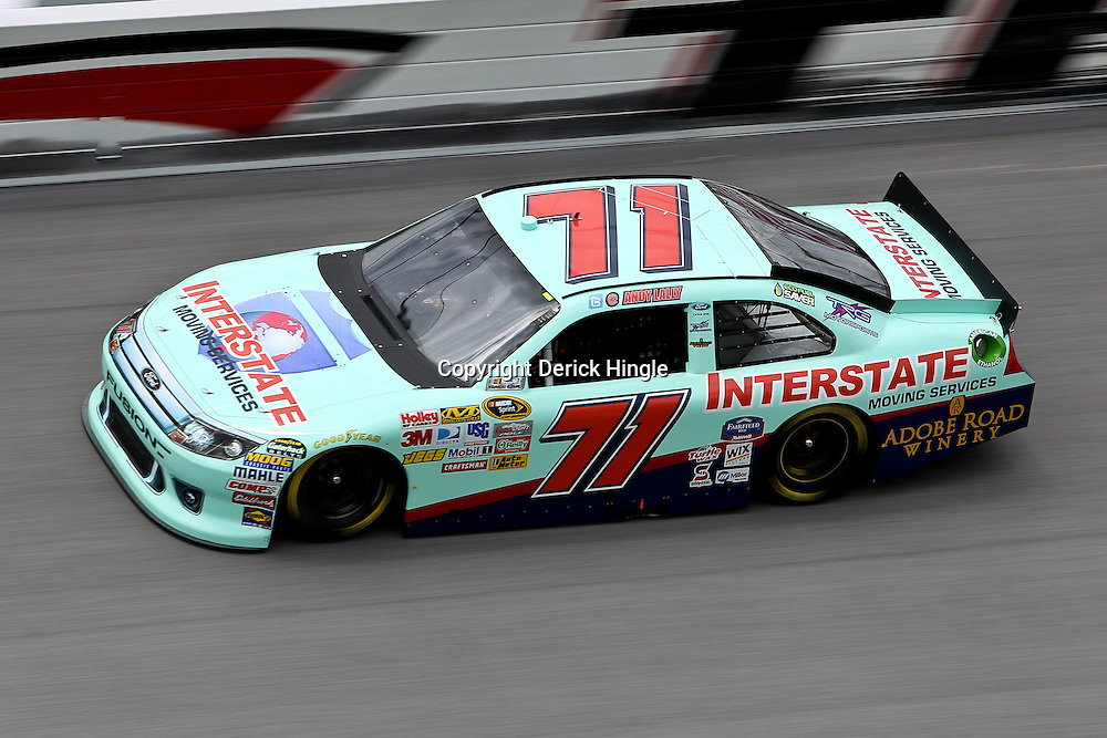 April 16, 2011; Talladega, AL, USA; NASCAR Sprint Cup Series driver Andy Lally (71) during qualifying for the Aarons 499 at Talladega Superspeedway.   Mandatory Credit: Derick E. Hingle