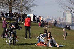 © Licensed to London News Pictures. 27/02/2021. London, UK. Members of the public relax in the sun in Greenwich Park in South East London. The national Lockdown is expected to begin to be lifted on the 8th of March with pupils returning to schools and two members of different households allowed to meet outdoors. Photo credit: George Cracknell Wright/LNP