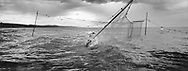 Salmon netter Jim Mitchell struggles to right a pole of a capsized 'jumper' net in waters off Kinnaber, Angus.<br /> Ref. Catching the Tide 35/00/10 (30th May 2000)<br /> <br /> The once-thriving Scottish salmon netting industry fell into decline in the 1970s and 1980s when the numbers of fish caught reduced due to environmental and economic reasons. In 2016, a three-year ban was imposed by the Scottish Government on the advice of scientists to try to boost dwindling stocks which anglers and conservationists blamed on netsmen.