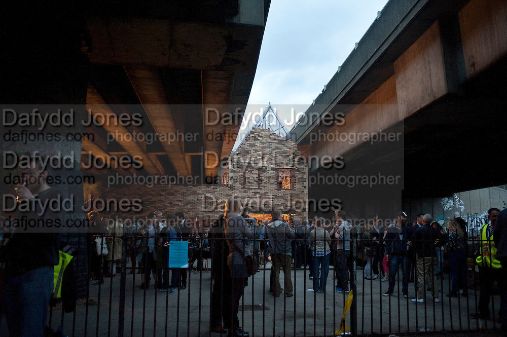The day before the opening night the folly is almost completed.-  FOLLY FOR A FLYOVER conceived and built by Assemble. Winner of the Bank of America Merrill Lynch award 2011. Hackney Wick. London. 23 June 2011. <br /> <br />  , -DO NOT ARCHIVE-© Copyright Photograph by Dafydd Jones. 248 Clapham Rd. London SW9 0PZ. Tel 0207 820 0771. www.dafjones.com.