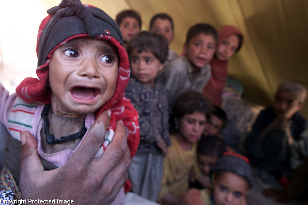 PIC SHOWS NEW AFGHAN REFUGEE ARRIVALS IN QUETTA PIC PAUL GROVER