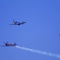 World War II fighters fly in an air show above Gallatin Field airport.