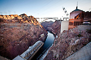 Hoover Dam, once known as Boulder Dam, is a concrete arch-gravity dam in the Black Canyon of the Colorado River, on the border between the U.S. states of Arizona and Nevada. When completed in 1936, it was both the world's largest hydroelectric power generating station and the world's largest concrete structure. It was surpassed in both these respects by the Grand Coulee Dam in 1945. It is currently the world's 38th-largest hydroelectric generating station