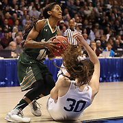 Courtney Williams, USF, drives past a falling Breanna Stewart, UConn, during the UConn Huskies Vs USF Bulls Basketball Final game at the American Athletic Conference Women's College Basketball Championships 2015 at Mohegan Sun Arena, Uncasville, Connecticut, USA. 9th March 2015. Photo Tim Clayton