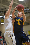Prior Lake center Connor Bair (42) goes up for a basket during the first half of the basketball game between Prior Lake and Apple Valley at Prior Lake High School, Friday, January 24, 2014.