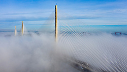 South Queensferry, Scotland, UK. 10th Jan 2020. Drone image of a spectacular cloud inversion at Queensferry Crossing Bridge with the lower half of the bridge shrouded in fog but the upper half in beautiful sunny weather. Iain Masterton/Alamy Live News