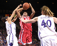 Western Kentucky forward Crystal Kelly (C) puts up a shot between Kansas State's Marlies Gipson (L) and JoAnn Hamlin (R), during the first half at Bramlage Coliseum in Manhattan, Kansas, March 28, 2006.  K-State defeated Western Kentucky 57-56 in overtime of the WNIT Semifinals.