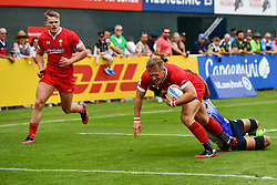 Ben Cambriani of Wales goes over for a try<br /> <br /> Photographer Craig Thomas/Replay Images<br /> <br /> World Rugby HSBC World Sevens Series - Day 3 - Saturday 7rd December 2019 - Sevens Stadium - Dubai<br /> <br /> World Copyright © Replay Images . All rights reserved. info@replayimages.co.uk - http://replayimages.co.uk