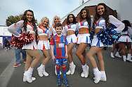 the Crystal Palace ' Crystals' Cheerleaders pose with for a photo with a young Palace fan outside Selhurst Park before k/o. Barclays Premier League match, Crystal Palace v West Bromwich Albion at Selhurst Park in London on Saturday 3rd October 2015.<br /> pic by John Patrick Fletcher, Andrew Orchard sports photography.