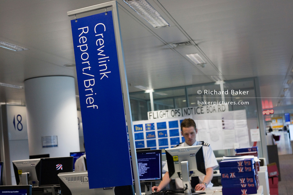 A pilot logs-on to access flight documents in the British Airways Crew Report Centre at Heathrow Airport's Terminal 5.