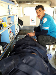 April 4, 2017 - Hatay, Hatay Province, Turkey - A medic helps a victim of nerve gas attack (possibly the powerful and lethal sarin nerve gas) in north-western Syria. First reports place the death toll at 70 to 100, many childern. Several reported that airstrikes had targeted clinics treating the wounded. Khan Sheikhoun, Idhib Province is a rebel-held town of 165,000. Around 30 Turkish ambulances came to the border in Hatay Province, Turkey for medical evacuation of victims after the Syrian toxic gas attack, then to be brought to Turkish medical aid. (Credit Image: © Ferhat Dervisoglu/Depo Photos via ZUMA Wire)
