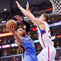 11 May 2014: Oklahoma City Thunder guard Russell Westbrook (0) goes for the layup against Los Angeles Clippers forward Blake Griffin (32) during the Los Angeles Clippers 101-99 victory over the Oklahoma City Thunder, during Game Four of the Western Conference Semifinals of the NBA Playoffs, at the Staples Center, Los Angeles, California, USA.