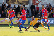 Newport's Aaron O'Connor scores his sides second goal. Skybet football league two match , Newport county v Dagenham & Redbridge at Rodney Parade in Newport, South Wales on Saturday 18th April 2015.<br /> pic by David Richards, Andrew Orchard sports photography.