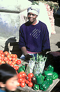 ECUADOR, MARKETS, CRAFTS Otavalo; Afro-Ecuadorian vendor