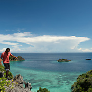 Jung papua balancing over the rocks of an island in Misool area, West-Papua.