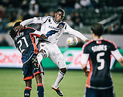 Los Angeles Galaxy forward Edson Buddle, right, and New England Revolution defender A.J. Soares battle for the ball during the second half of an MLS soccer match, Saturday, March 31, 2012, in Carson, Calif. The Revolution won 3-1. (AP Photo/Bret Hartman)