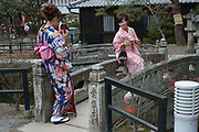 Young women photographing each other in their kimonos. Kyoto, Japan