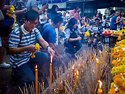 31 DECEMBER 2017 - BANGKOK, THAILAND:  People light prayer candles and incense at Erawan Shrine in Bangkok on New Year's eve. Many Thais go to temples and shrines to pray and meditate during New Year's Eve and New Year's Day.   PHOTO BY JACK KURTZ