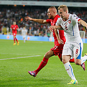 Turkey's Gokhan Tore (L) and Czech Republic's David Limbersky (R) during their UEFA Euro 2016 qualification Group A soccer match Turkey betwen Czech Republic at Sukru Saracoglu stadium in Istanbul October 10, 2014. Photo by Aykut AKICI/TURKPIX