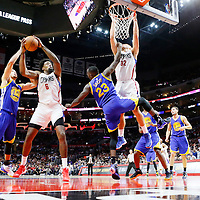 19 November 2015: Los Angeles Clippers center DeAndre Jordan (6) grabs a rebound against Golden State Warriors guard Stephen Curry (30) and Golden State Warriors forward Draymond Green (23) during the Golden State Warriors 124-117 victory over the Los Angeles Clippers, at the Staples Center, Los Angeles, California, USA.