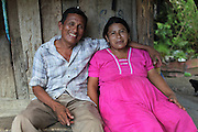 """Luciano Sho (left), 52, and Eugenia Sho, 48, are cacao growers from San Antonio and have 13 children together. Mr. Sho switched from rice farming in 2004 and joined the TCGA in 2005. He now has 17,000 cacao trees and is one of the organization's most successful members. """"Thanks to the TCGA and Fair Trade for providing us great benefits. I have 13 children and many have been granted Fair Trade scholarships. I am very proud to belong to the TCGA."""" Toledo Cacao Growers' Association (TCGA), San Antonio, Toledo, Belize. January 28, 2013."""