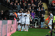 Swansea city's Wilfried Bony © celebrates after he scores his sides 1st goal to equalise at 1-1. Barclays Premier league, Swansea city v Manchester City at the Liberty Stadium in Swansea,  South Wales on  New years day Wed 1st Jan 2014 <br /> pic by Andrew Orchard, Andrew Orchard sports photography.