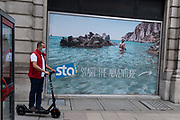 A poster showing a utopian beach is seen outside the Victoria offices of international budget flight and holiday booking service, STA Travel whose parent company has just announced its insolvency, a casualty of the Coronavirus pandemic, on 24th August 2020, in London, England. STA Travel (Student Travel Australia) was a travel agency specializing in youth travel. It was owned by the Swiss Diethelm Keller Holding (DKH) and employed almost 2,000 employees in over 200 stores worldwide. STA dated back to 1979 when two students in Australia organized the company after returning from their travels.