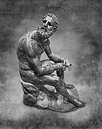 Rare original Greek bronze statue of an Athlete after a boxing match, a 1st cent BC. The athlete, seated on a boulder, is resting after a boxing match. The boulder is a modern addition that replicates the ancient original. The face, ears, and nose are severely wounded by blows received during the match. No wounds appear on the body since ancient boxing practices made the afce the main target. The boxer is only wearing a sort of loin cloth (kynodesme) around his waist. Elaborate leather gloves (himantes oxeis) protect the hands and the forearms. They consist of thick leather straps that bind the four fingers, leaving the thumb free. On the forearms the gloves are bordered with fur lining. A series of marks on the straps above the left ring fingers seem to be a signature of the Athenian sculptor Appolonios, son of Nestor who was active during the 1st century B.C. Careful analysis shows that the marks are actually corrosions of the bronze surface. The Greek letter 'a' is impressed on the middle toe of the left foot and is probably a mark identifying the workshop that produced the statue. The statue of the boxer is of the highest quality with a highly detailed rendition of the athletic anatomy and facial feature. The artist was clearly inspired by the style of Greek sculptor Lysippus and scholars generally consider it an original Greek bronze of the 1st Century B.C. . The National Roman Museum, Rome, Italy. Black and White Wall art print by Photographer Paul E Williams
