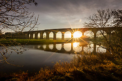 © Licensed to London News Pictures. 23/11/2020. Arthington UK. A commuter train crosses Arthington viaduct as the sun rises this morning in Yorkshire. Photo credit: Andrew McCaren/LNP