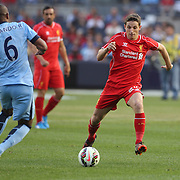 Fernando, (left), Manchester City, is challenged by Joe Allen, Liverpool, during the Manchester City Vs Liverpool FC Guinness International Champions Cup match at Yankee Stadium, The Bronx, New York, USA. 30th July 2014. Photo Tim Clayton
