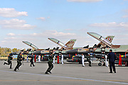 Israeli Air Force (IAF) squadron of F-16D Fighter jets on the ground, pilots running to cockpits