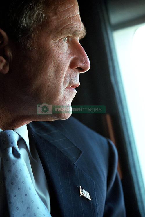 United States President George W. Bush looks at the Pentagon in Washington, DC from Marine One on his way to visit New York, New York on Friday, September 14, 2001.<br /> Mandatory Credit: Eric Draper - The White House via CNP /ABACAPRESS.COM