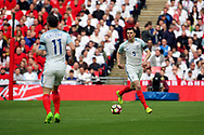 Michael Keane of England dribbling during the FIFA World Cup Qualifier group stage match between England and Lithuania at Wembley Stadium, London, England on 26 March 2017. Photo by Matthew Redman.
