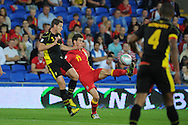 Gareth Bale of Wales © battles for the ball with Jan Vertonghen (5) of Belgium. World cup 2014 qualifying match, Group A, Wales v Belgium at the Cardiff city stadium in Cardiff, South Wales on Friday 7th Sept 2012.  pic by  Andrew Orchard, Andrew Orchard sports photography,