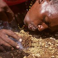 Africa, Kenya. Maasai elder demonstrates fire starting