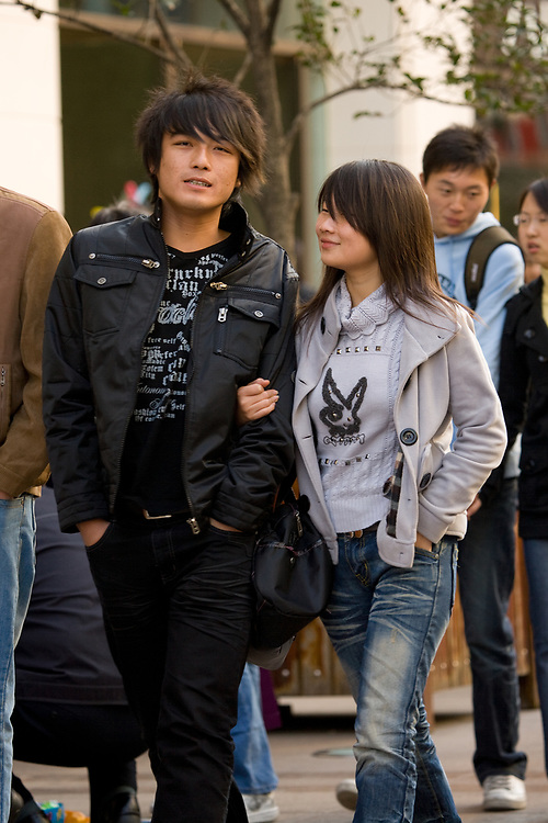 Shanghai, China, Asia - Young Chinese fashion couple at Nanjing Road in Shanghai.