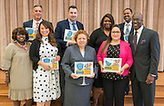 Ken Huewitt poses with honorees after a Children at Risk awards presentation to area schools at Pilgrim Academy, June 6, 2016.