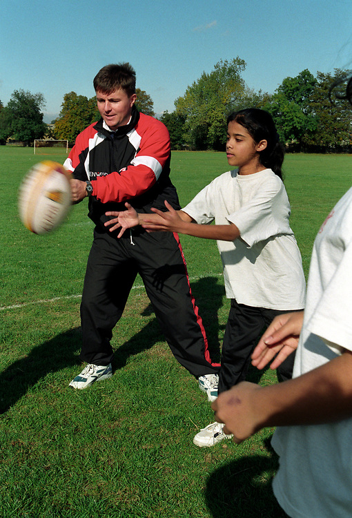 Females playing rugby at a secondary school,