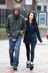 © Licensed to London News Pictures. 24/02/2016. Leeds UK. Kim Ager arrives at Leeds Magistrates court with an unidentified man this morning for sentence. Ager admitted handling stolen goods worth £3234 & her former partner Matthew Ingham was found guilty of theft. The couple stole laptops & video equipment from the Leeds General Infirmary cancer ward where their son Callum was being treated for Neuroblastoma, a cancer which attacks the nervous system. Photo credit: Andrew McCaren/LNP