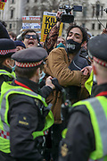 Police restrain a demonstrator during clashes following a 'Kill the Bill' protest outside the Houses of Parliament in London on Saturday, April 3, 2021. The demonstration is against the contentious Police, Crime, Sentencing and Courts Bill, which is currently going through Parliament and would give police stronger powers to restrict protests. (Photo/ Vudi Xhymshiti)