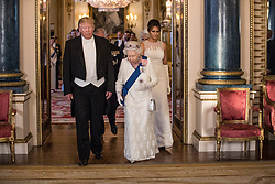(left to right) US President Donald Trump, Queen Elizabeth II and Melania Trump, during a group photo ahead of the State Banquet at Buckingham Palace, London, on day one of US President Donald Trump's three day state visit to the UK.