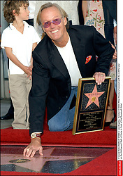 File photo - © Lionel Hahn/ABACA. 51582-3. Los Angeles-CA-USA, October 22 2003. Peter Fonda is honored with the 2,241st star on the Hollywood Walk of Fame in front of the Roosevelt Hotel. Peter Fonda, the star, co-writer and producer of the 1969 cult classic Easy Rider, has died at the age of 79. Peter Fonda was part of a veteran Hollywood family. As well as being the brother of Jane Fonda, he was also the son of actor Henry Fonda, and father to Bridget, also an actor.