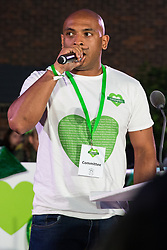 London, UK. 14 June, 2019. Karim Mussilhy of Grenfell United addresses members of the Grenfell community at a gathering following the Grenfell Silent Walk on the second anniversary of the Grenfell Tower fire in which 72 people died and over 70 were injured.