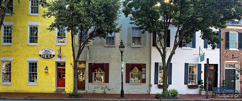 A row of shops along Caroline Street in the historic district of Fredericksburg, VA.