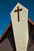 A large cross adorns the front of a church near Waimea on the island of Kauai, Hawaii.