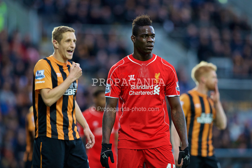 KINGSTON-UPON-HULL, ENGLAND - Tuesday, April 28, 2015: Liverpool's Mario Balotelli with against Hull City's Michael Dawson during the Premier League match at the KC Stadium. (Pic by Gareth Jones/Propaganda)